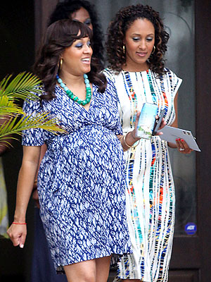 tia mowry baby shower pictures. tia-aby-bump
